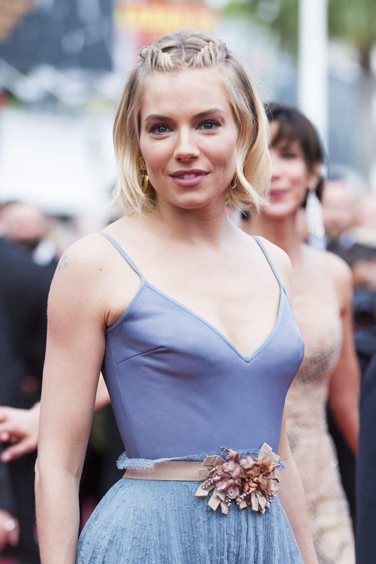 Les boucles d'oreilles très palme d'or de Sienna Miller, membre du jury.