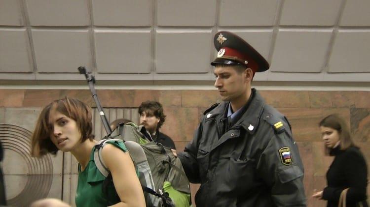Pussy_versus_Putin_Film_Frame,_Nadezhda_Tolokonnikova_Is_Taken_into_Police_Custody_Moscow_Metro_2011